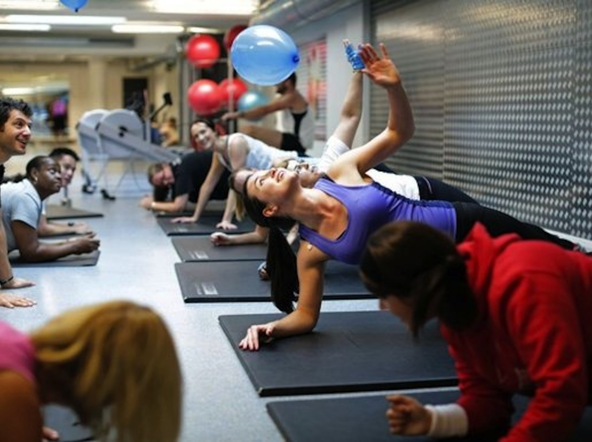Male and female members exercising at The Gym Group