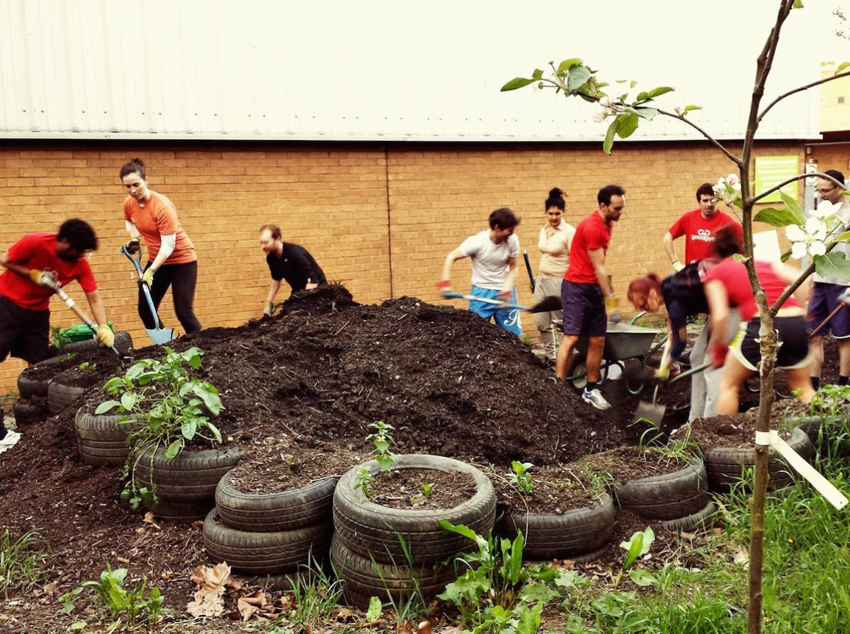Large group of GoodGym runners gardening in Camden North London
