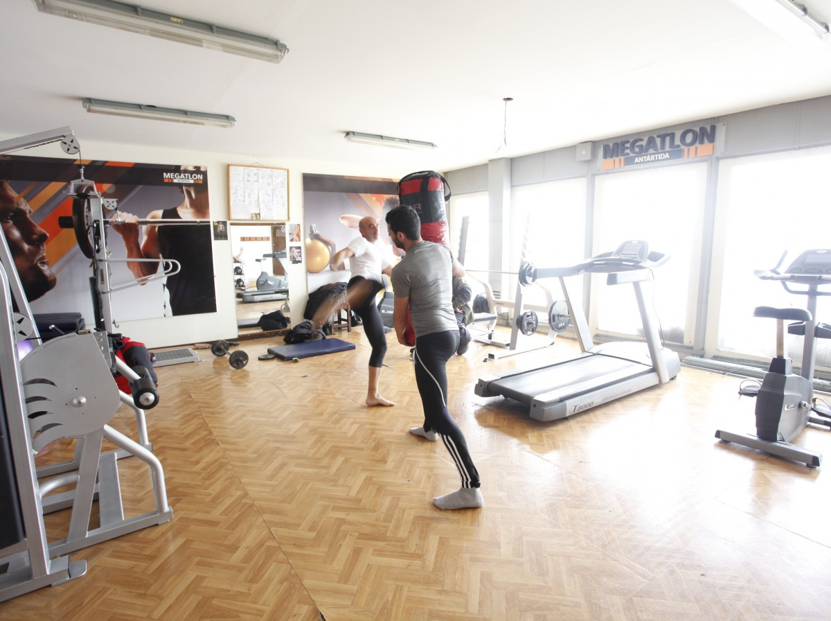 Two men exercising in the gym at Residents of Marambio Base in the Antarctica