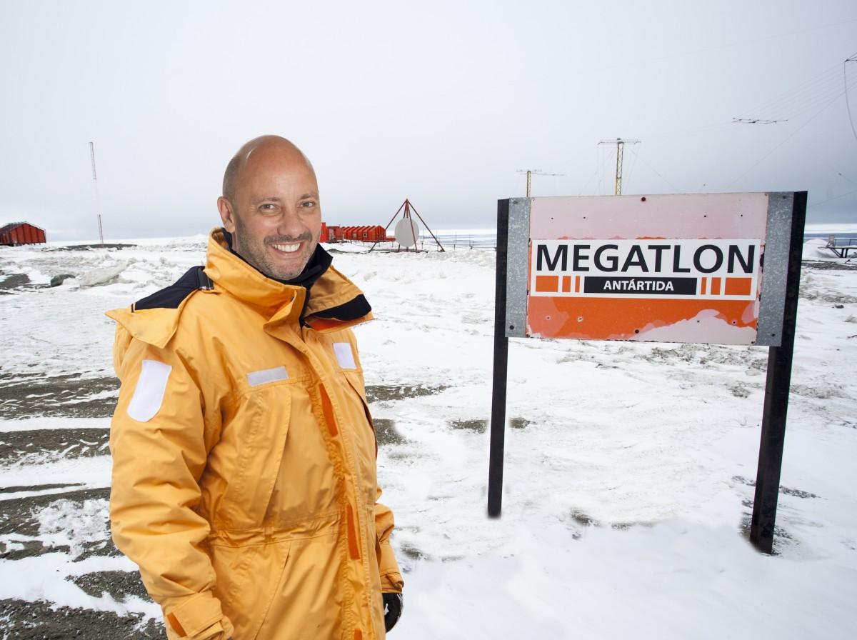 Fernando Storchi standing next to a Megatlon sign while visiting Marambio Base Antarctica