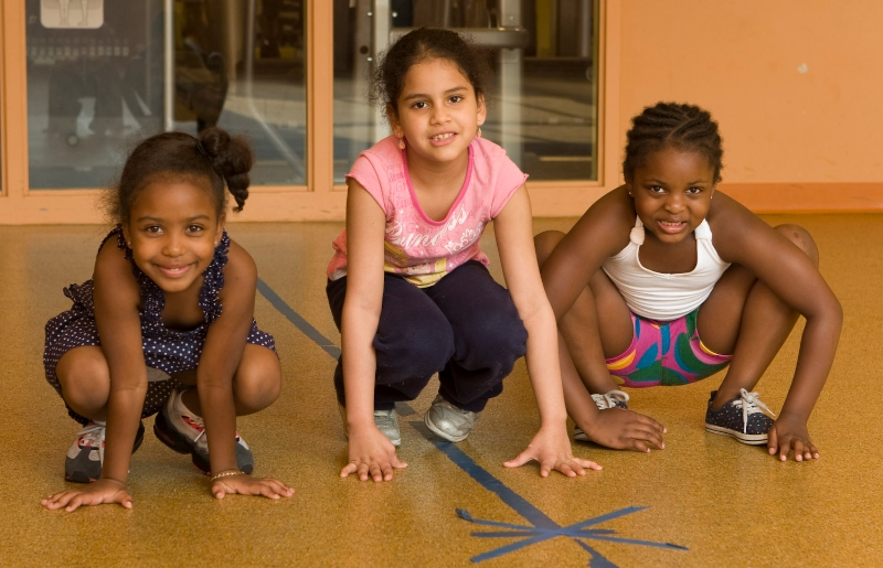 Three young children taking part in Fitspiration (Healthy Inspiration meets Perspiration!) empowers youth ages 5-12 from the Boston neighborhoods