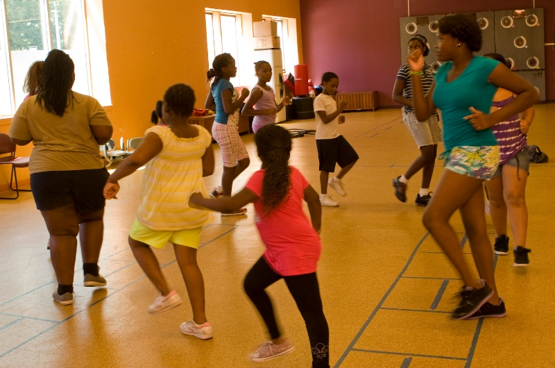 Group of nine children of different ages aking part in Fitspiration (Healthy Inspiration meets Perspiration!) a physical activity programme for kids aged 5-12 from the Boston neighborhoods