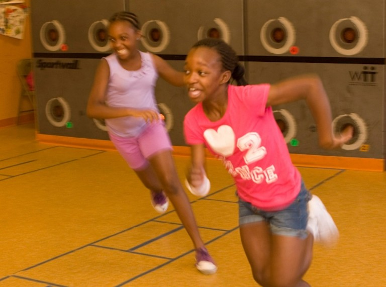 Two girls aged around 12 taking part in Fitspiration (Healthy Inspiration meets Perspiration!) a physical activity programme for kids aged 5-12 from the Boston neighborhoods