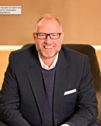 Picture of a smiling Philip Newborough, co-founder of impact investor, Bridges Fund Management